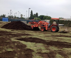 Professional Turf Specialties lays down compost at Fullerton College. Photo: Agromin