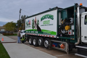 Barry Morton, president and CEO of Morton's Landscape Development, provided his own compost and blower truck for the field repair.