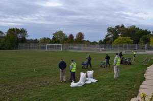 Volunteers from Weed Pro, Weed Man, Schill Grounds Management and Morton's Landscape Development arrived early to begin revitalizing the field.