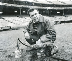 Pat Santarone draining the outfield at Memorial Stadium in Baltimore, MD before a 1979 World Series game. Photo courtesy of Beacon Athletics