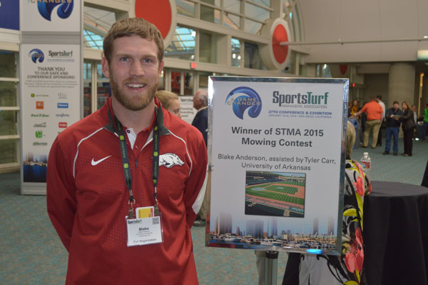 Anderson with signage featuring his winning design at the 2016 STMA Conference in San Diego.