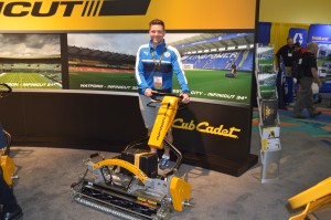John Ledwidge, grounds manager, Leicester (England) City Football Club, poses with one of the Infinicut walk-behind mowers he uses on his pitch back home. The technology was recently acquired by Cub Cadet.