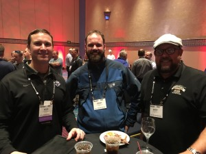 Kevin White, athletic field manager, University of Portland (Ore.), Jeremy Nelson, City of Portland (Ore.), and Barry Jameson, lead grounds maintenance at Taft (California) Union High School, enjoy some food, drinks and great conversation at the Welcome Event sponsored by Toro and Covermaster.